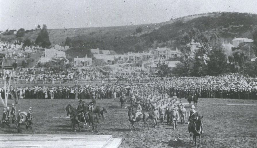 Troops gathering at the Oval Dunedin before departure for the Second Boer War from Port Chalmers, Dunedin.  Hocken Library Dunedin.