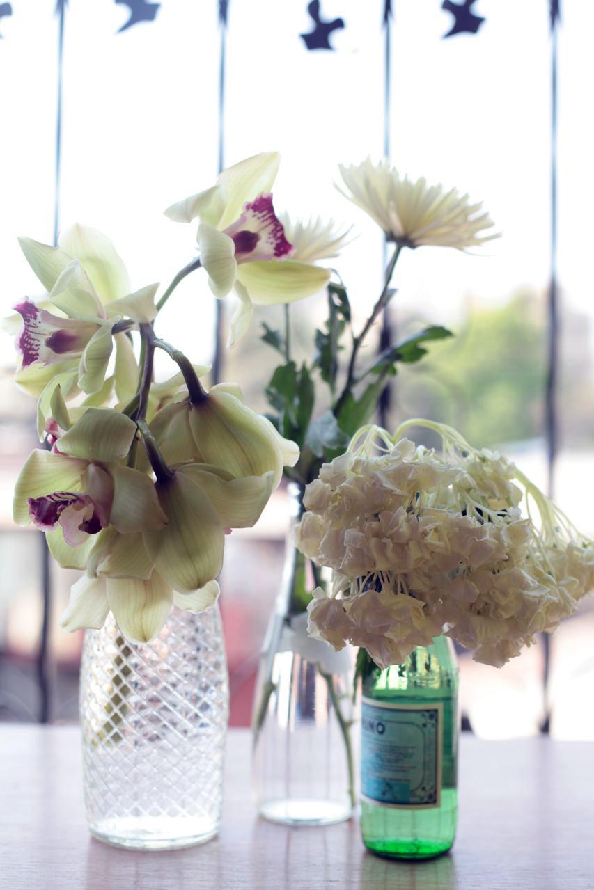 glass bottle vases flowers.jpg