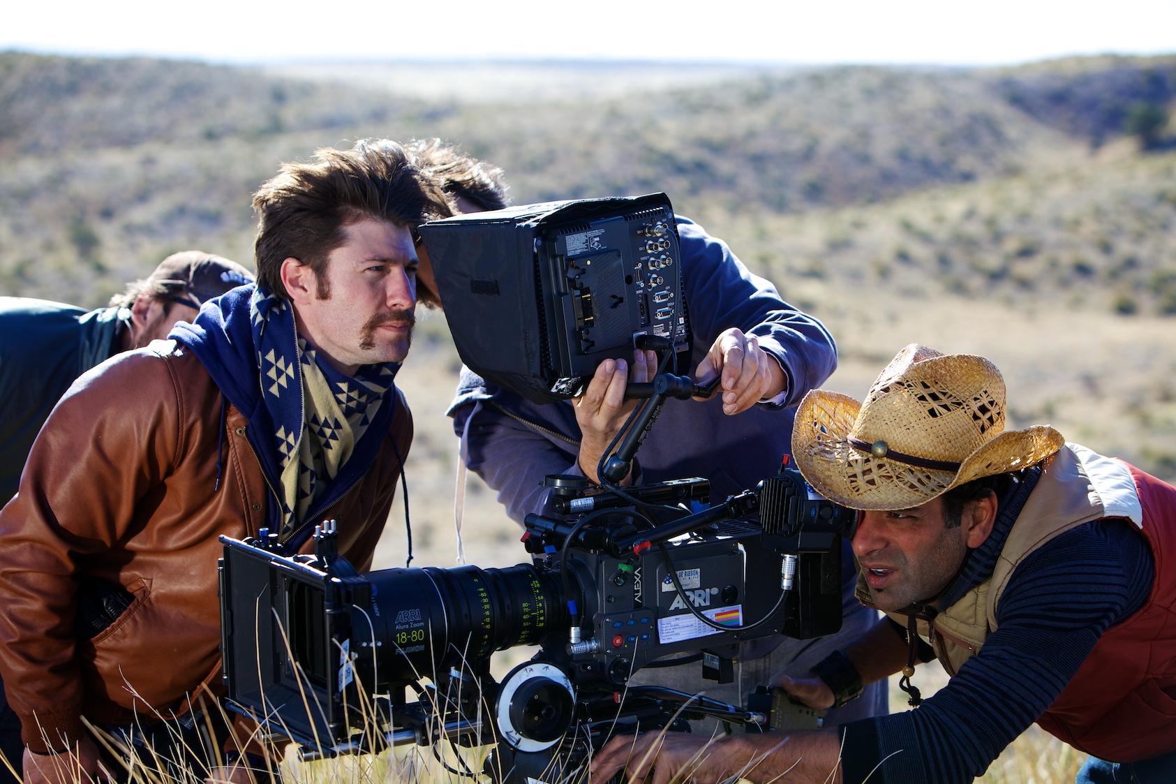 Director David Redish looks at the monitor while DP, Mark David frames apivotalshot in Marfa, Texas.