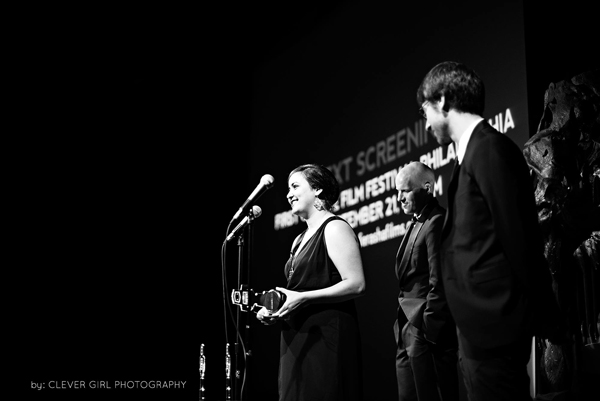 Amanda Danziger, founder and filmmaker at Ferasha Films accepts an award from the Philadelphia Geek Awards for Best Indie Feature Film of the Year for  The Backyard Philly Project. Photo by Clever Girl Photography.