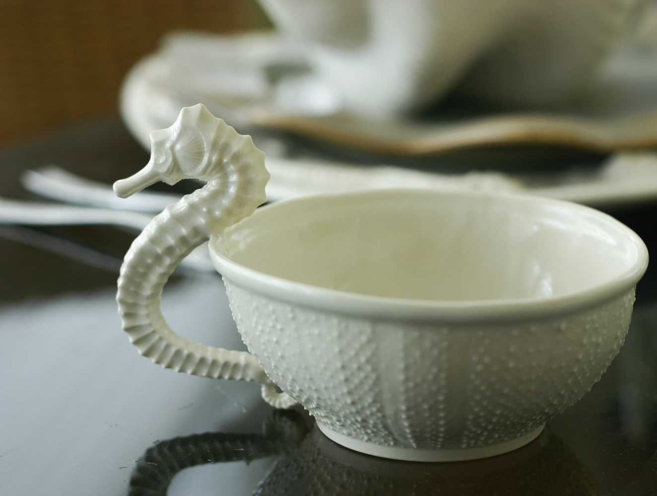 Seahorse and Sea Urchin porcelain Teacup  in morning light. Click image to enlarge.