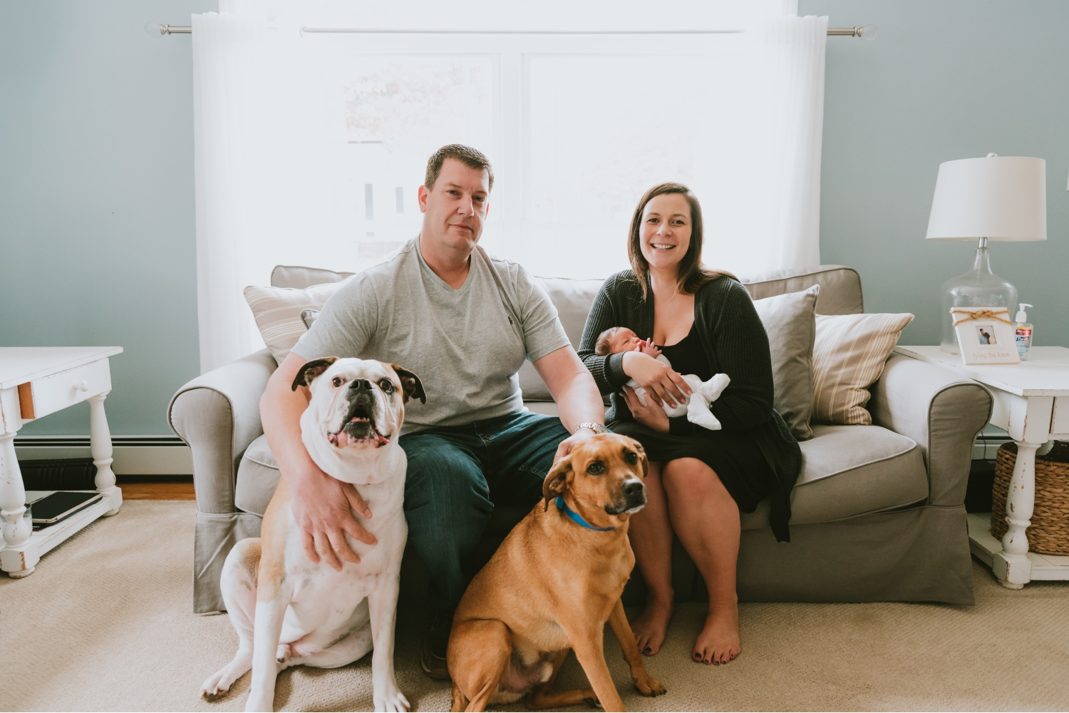 Picture-Of-Family-With-Dogs-And-Newborn-On-Couch-During-Newborn-Photography-Session-Ocean-County-New-Jersey