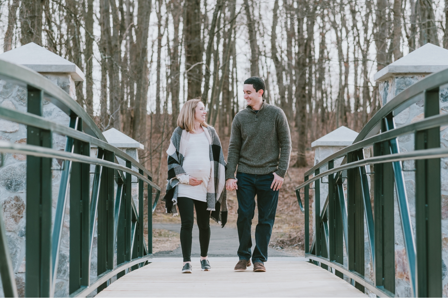 Expecting Twin Parents Walking on Bridge in Morris County New Jersey