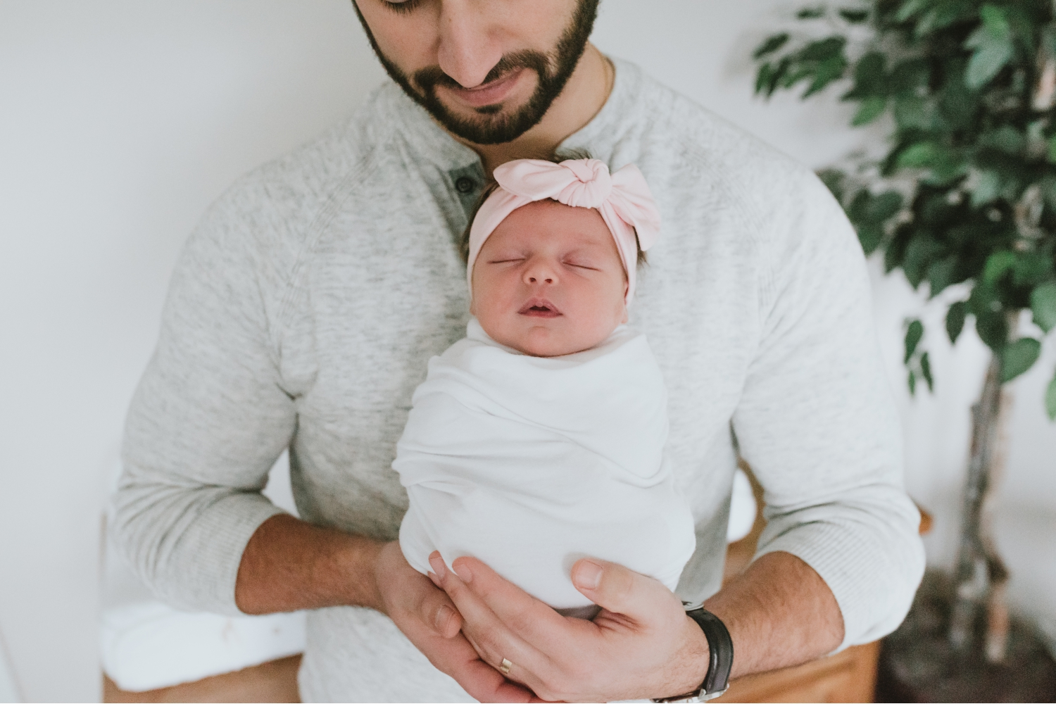 Daddy-Holding-Newborn-Girl