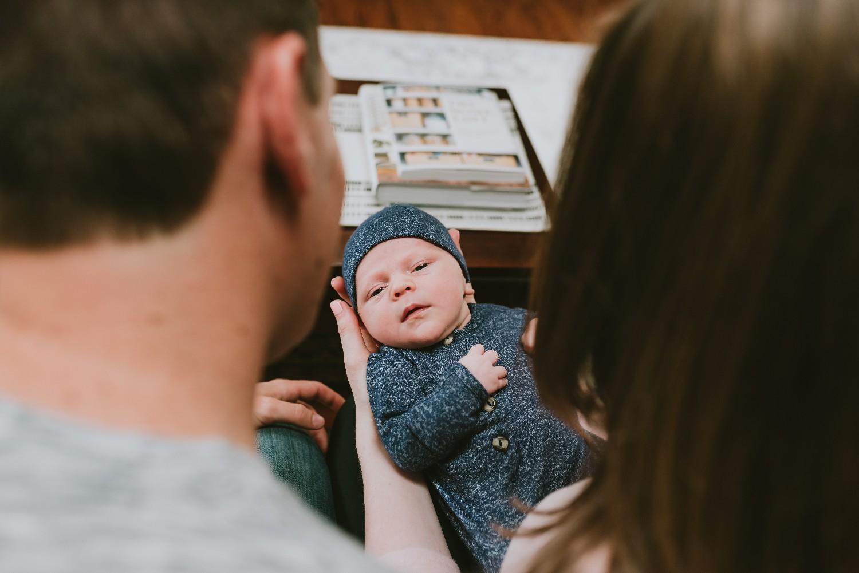 Shot-Of-Newborn-Between-Parents