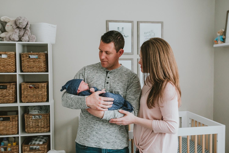 Parents-And-Newborn-In-Nursery
