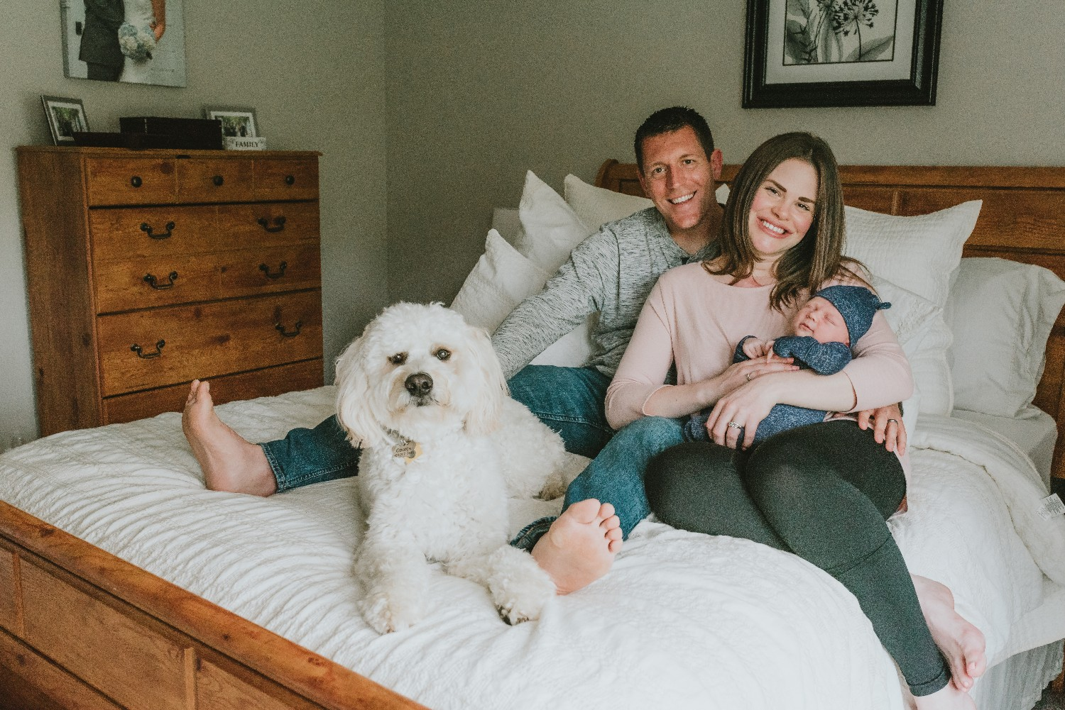 Family-With-Dog-In-Bed