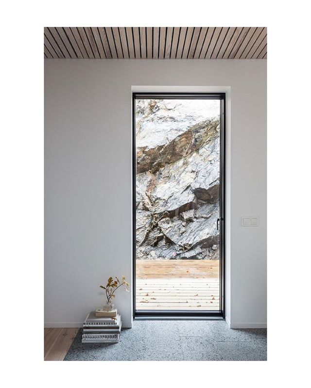 Nestled into the rocks with views of the Baltic Sea sits Villa Olausson in Tyresö Sweden. Designed by Anders Holmberg Architects.   #architecture #interiors #minimalist #modern  #details #sweden #baltic #sea  #landscape #materials #rock #wood #view #escape #faraway #fellsandes