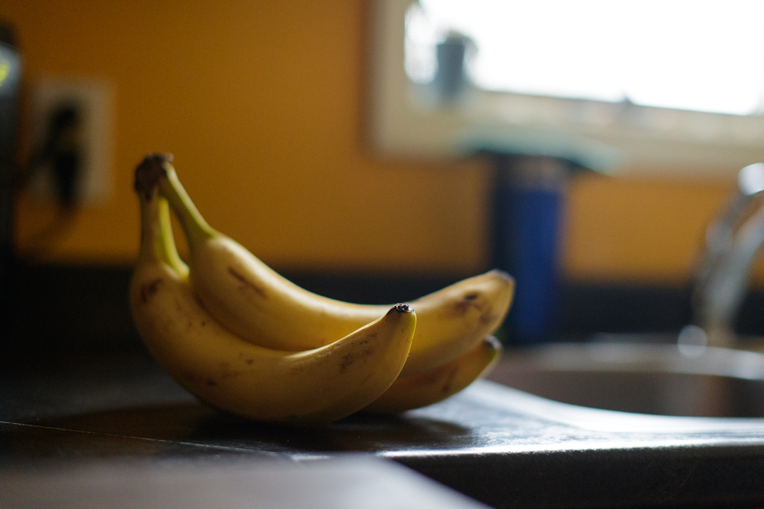 Bananas on a kitchen counter