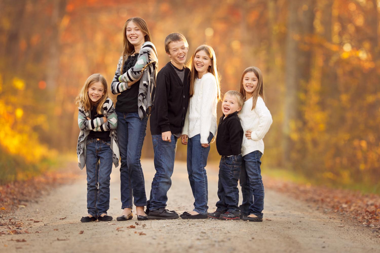 Siblings getting photo taken in the woods in South Kingstown, RI
