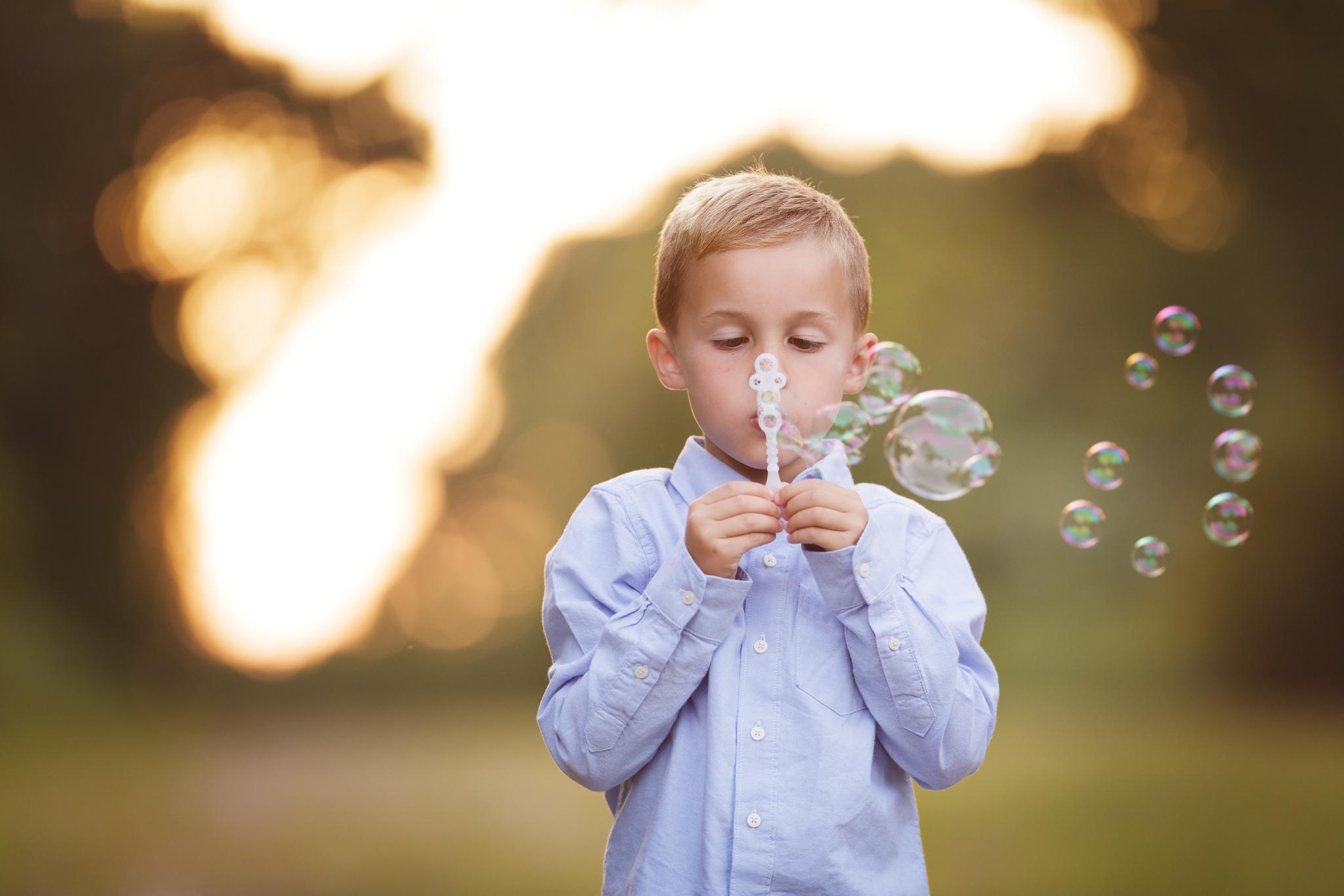 child blowing bubbles in Narragansett, RI