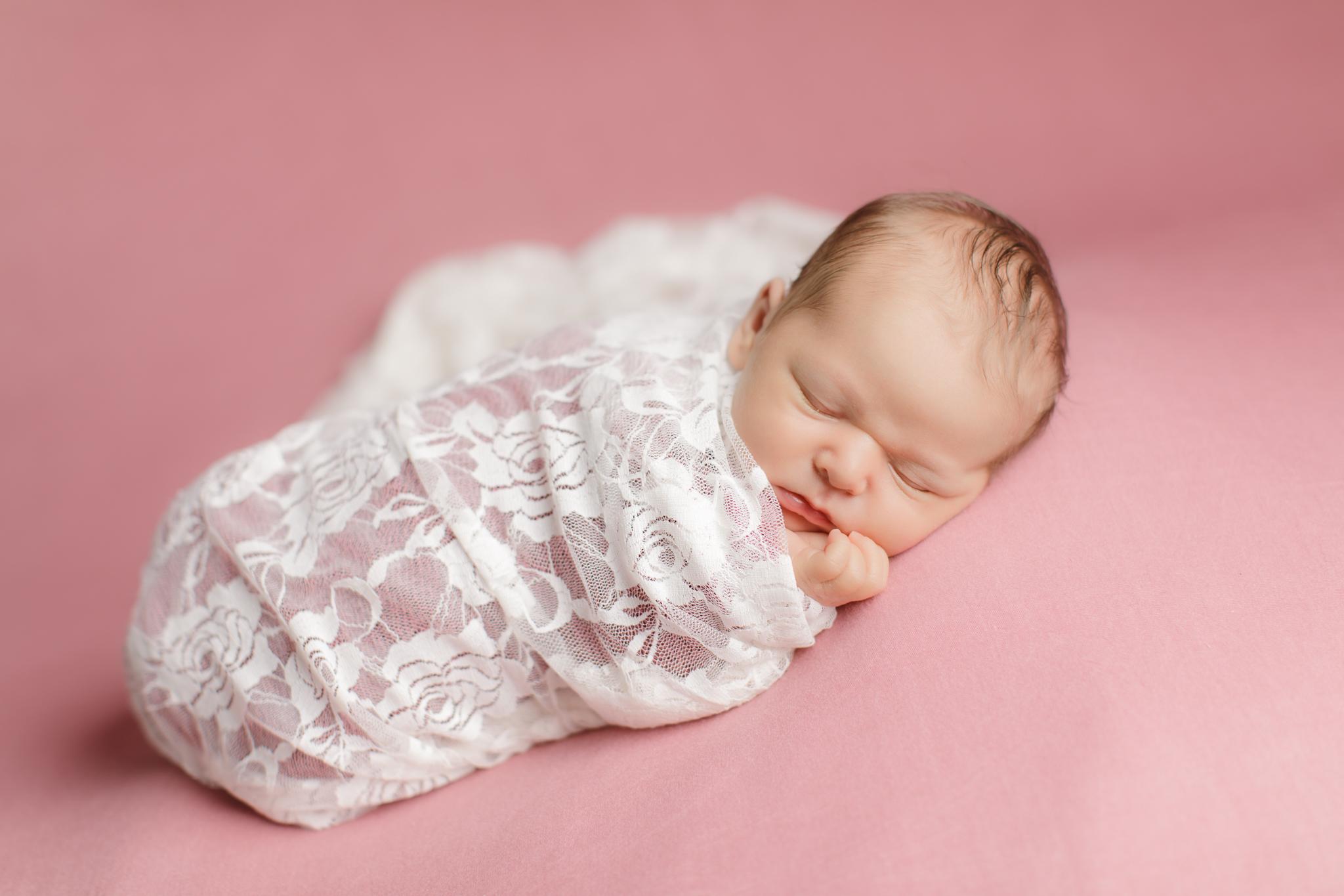Newborn portrait on pink backdrop in Wakefield, RI
