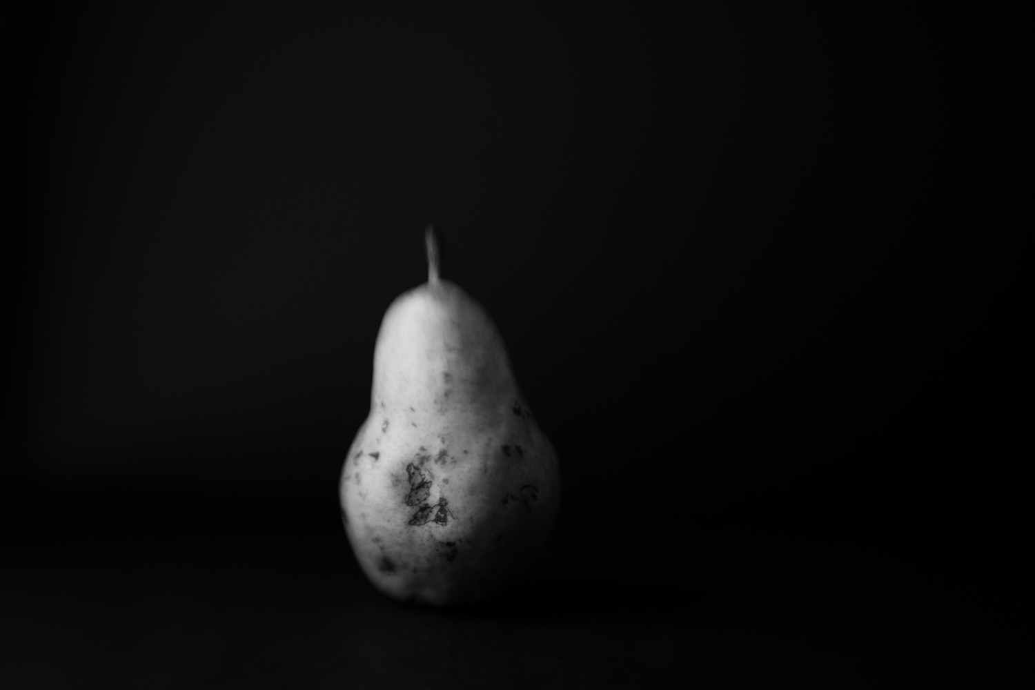 black and white photo of a pear