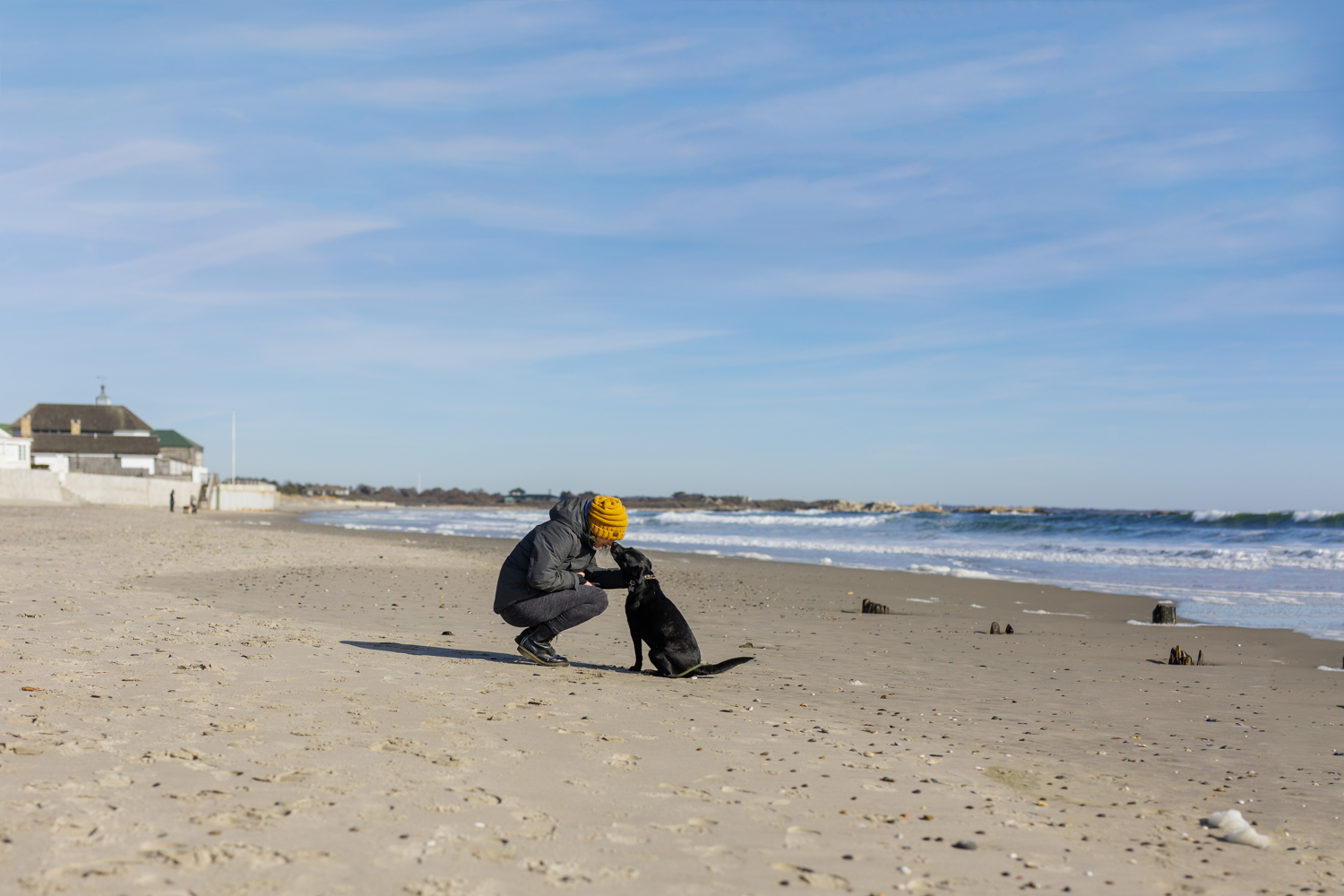 woman and dog on Narragansett Town Beach