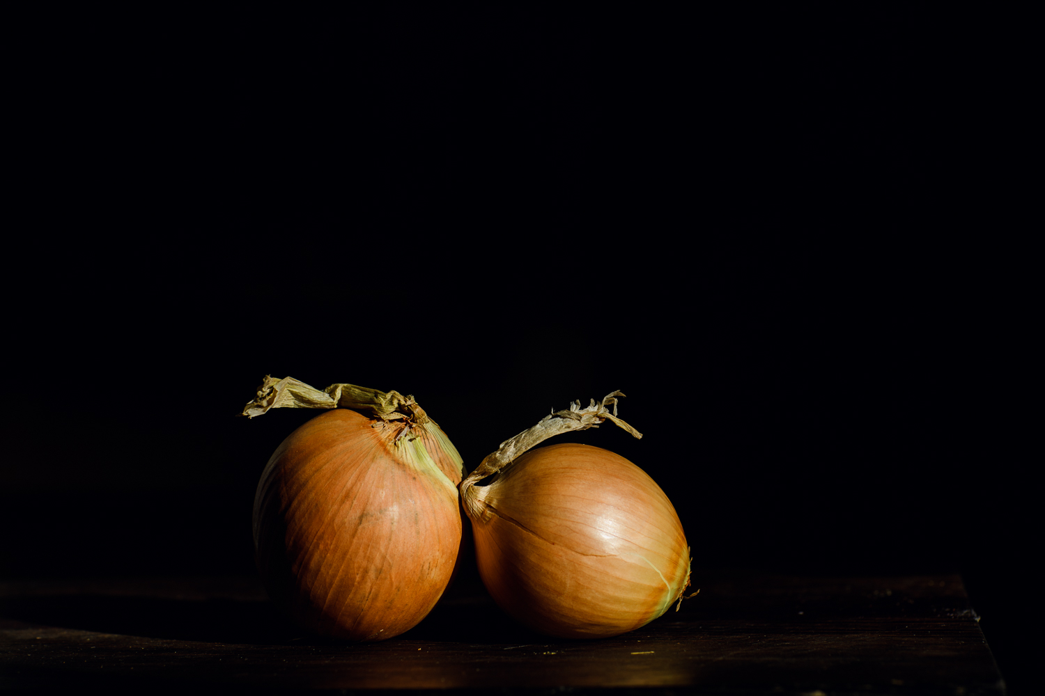 two onions on a cutting board