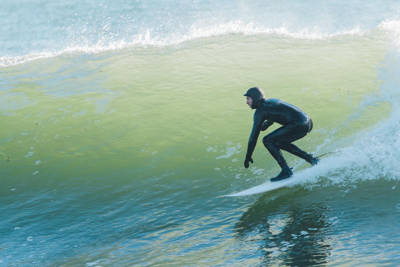 surfer at Monahan's Dock in Narragansett, RI