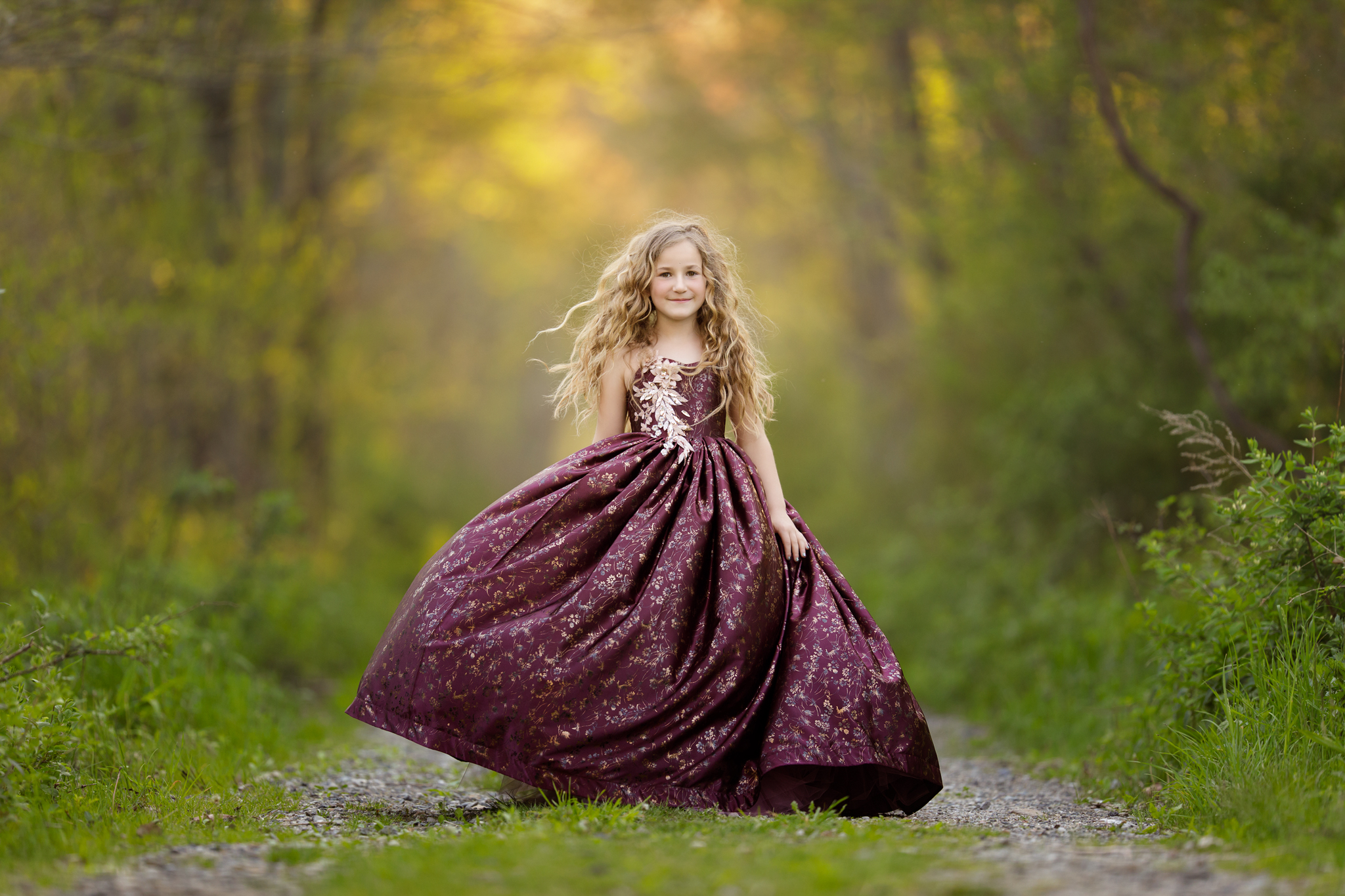 girl twirling in the woods in Wakefield, RI