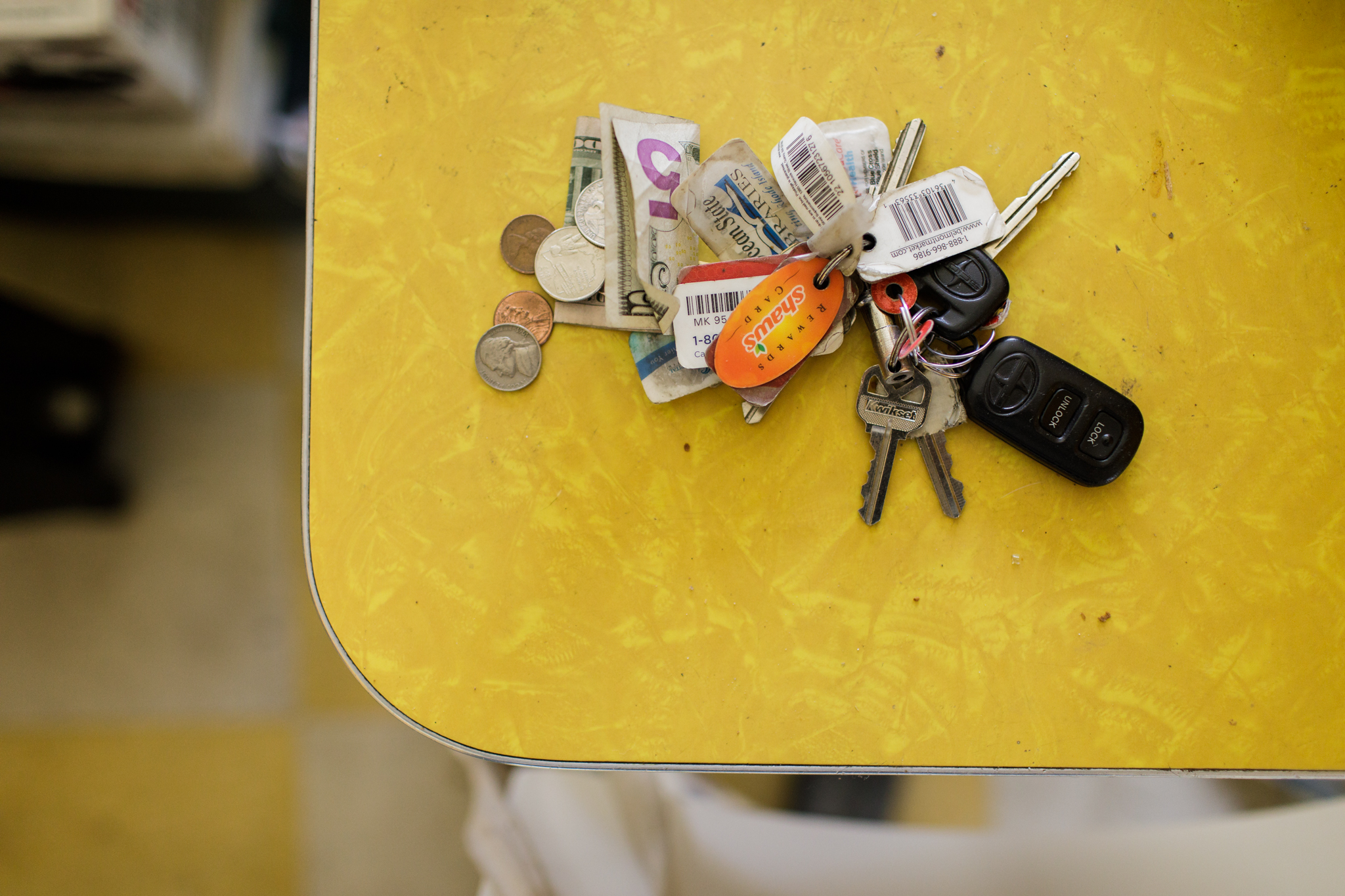money and keys on a table