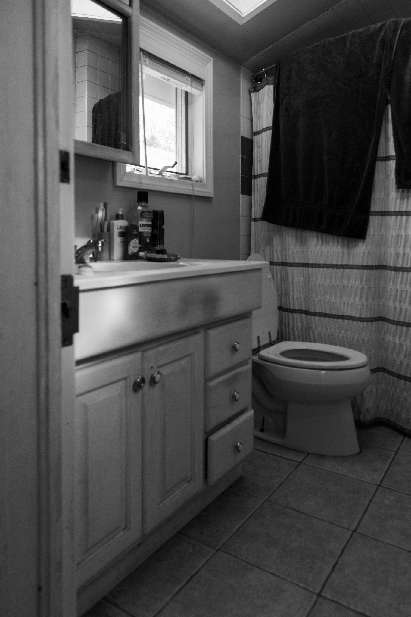 image of a bathroom viewed through a doorway