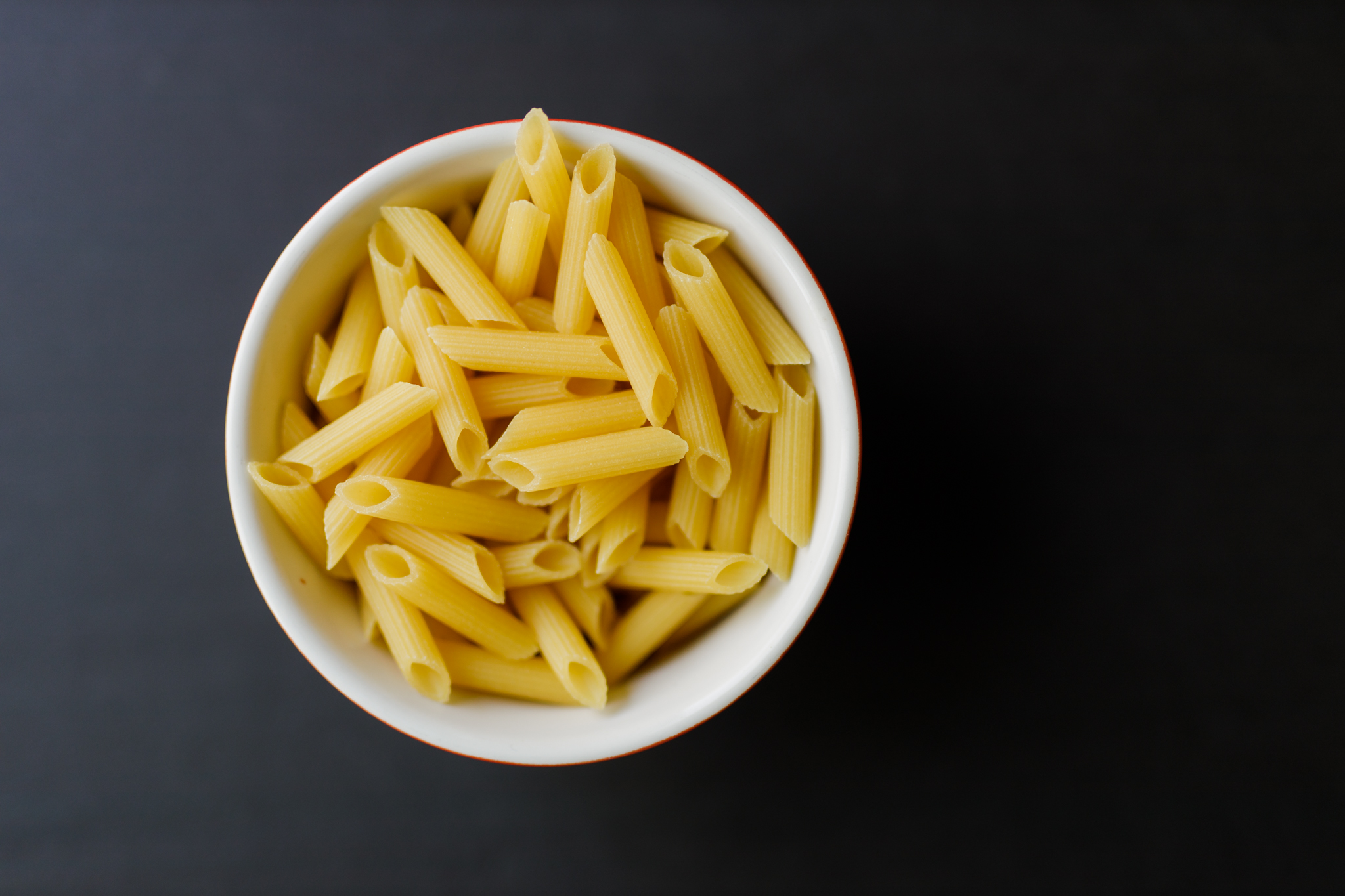 uncooked gluten free pasta in a bowl