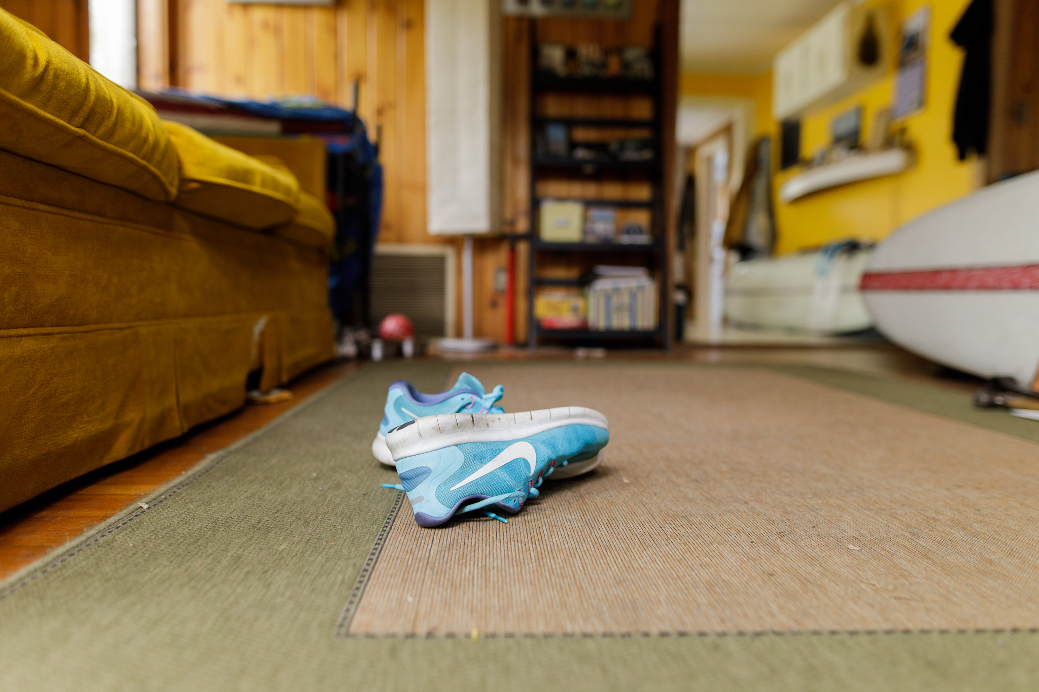 Nike sneakers on a living room rug