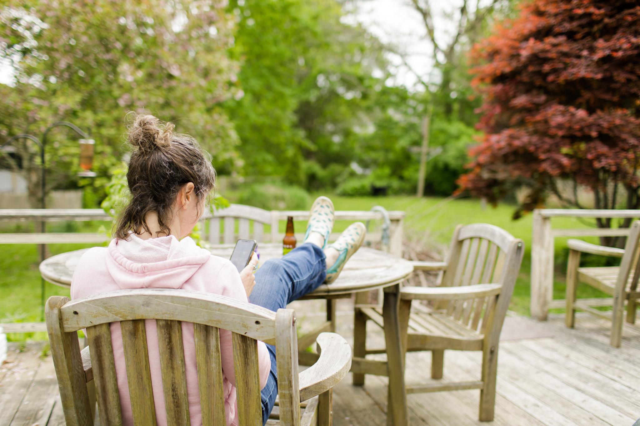 woman sitting on deck in Wakefield, RI