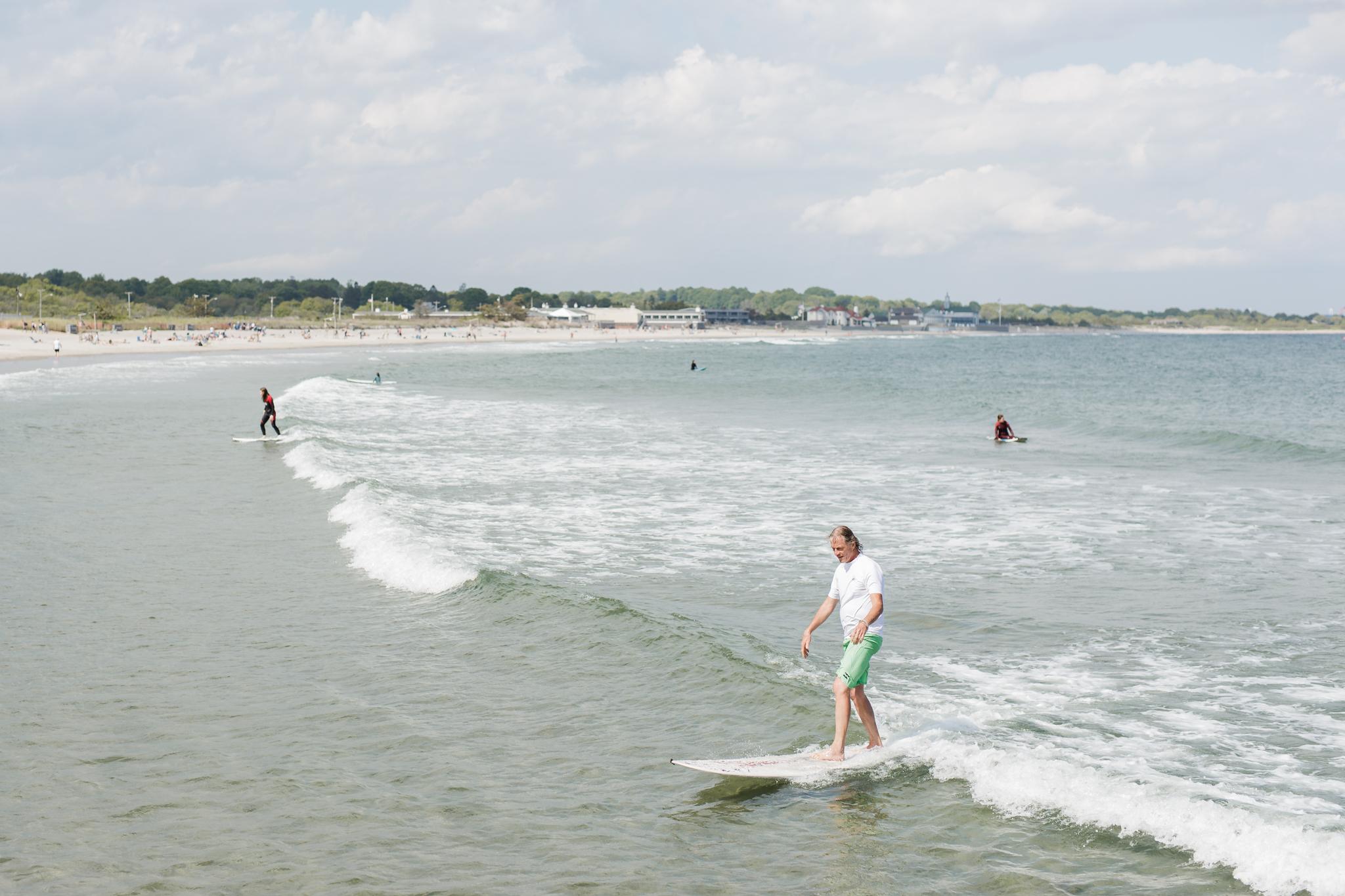 surfers at Narragansett Town Beach in Narragansett, RI