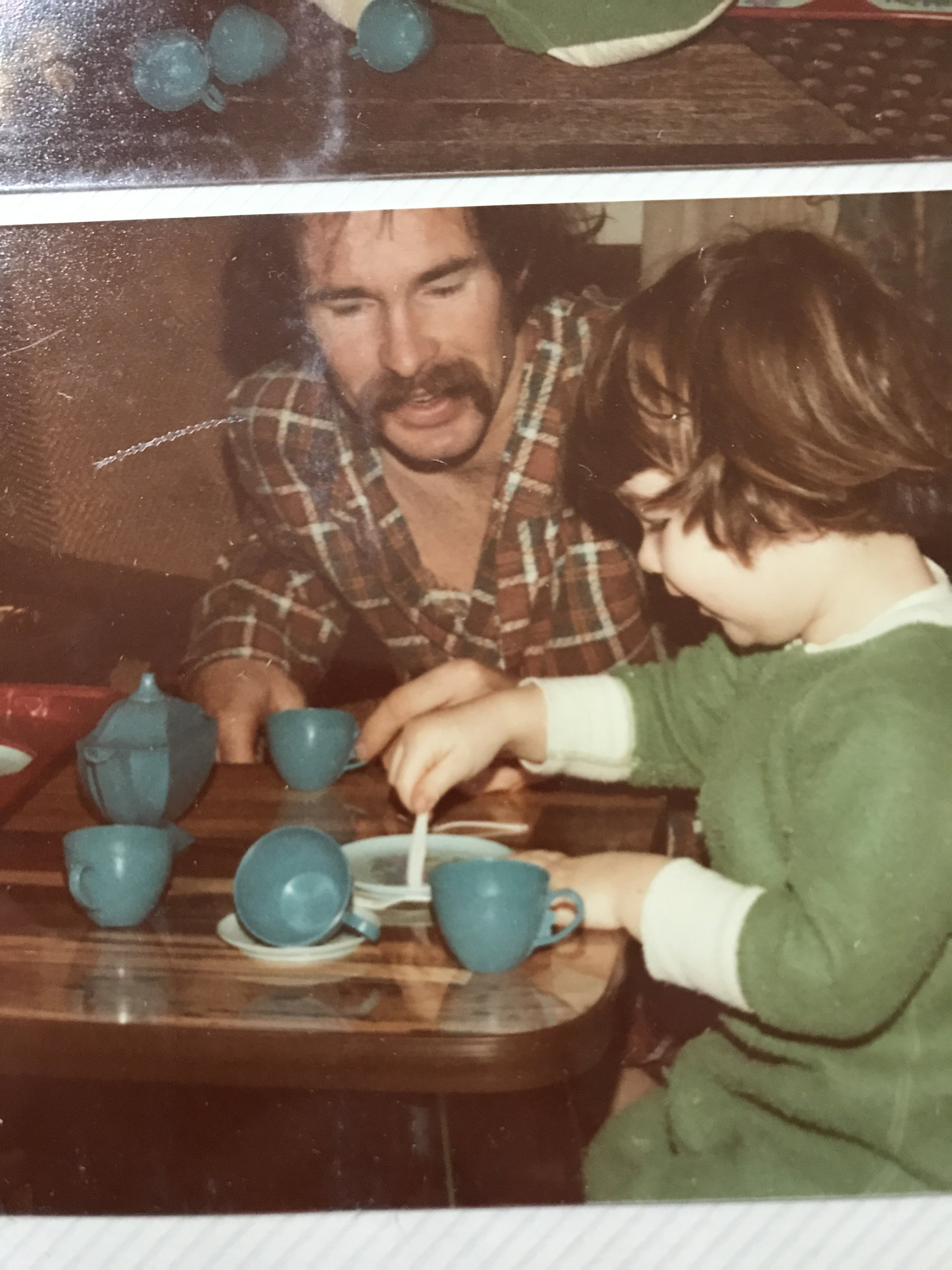 father and daughter having a tea party