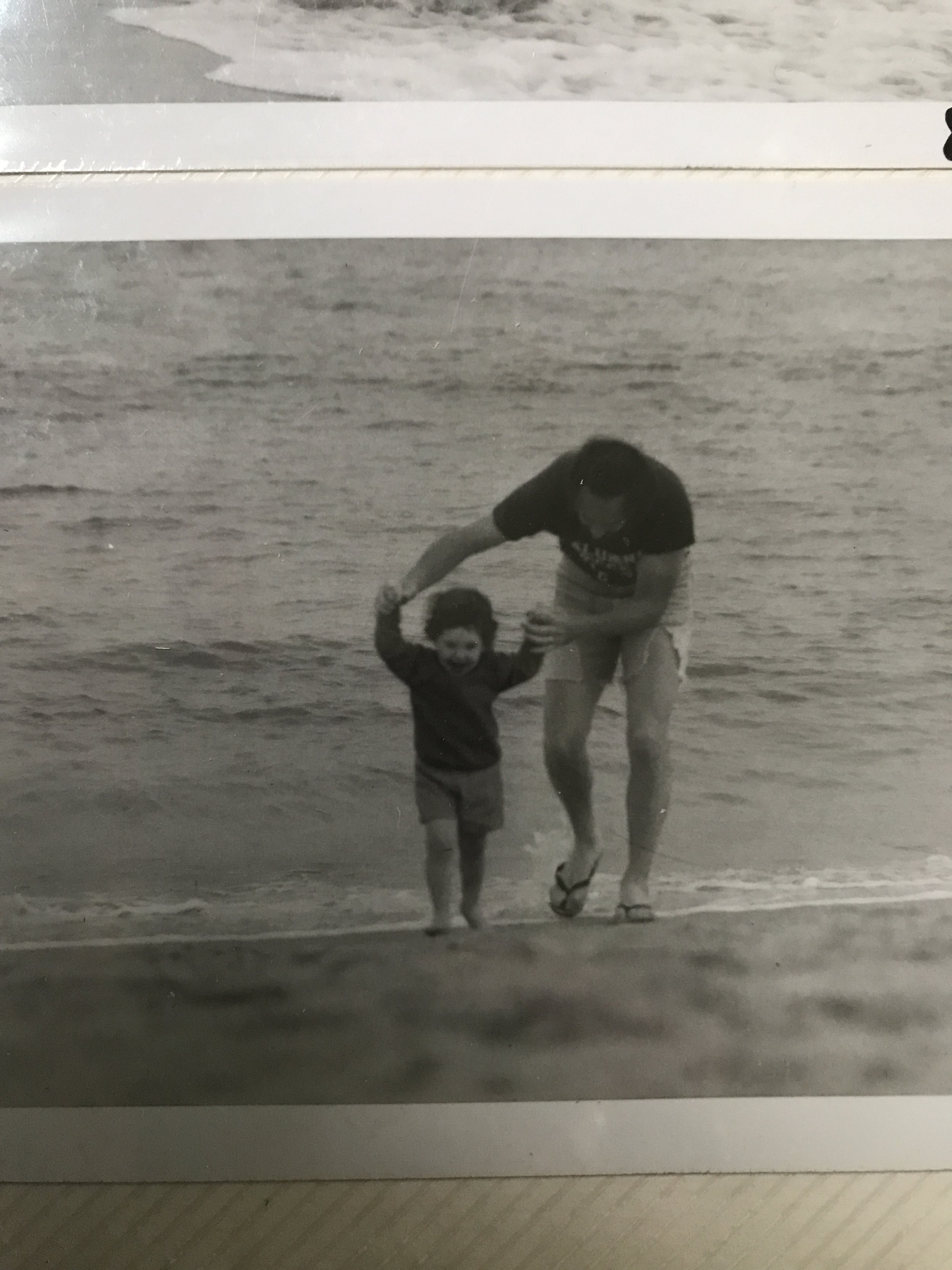man with child at the beach
