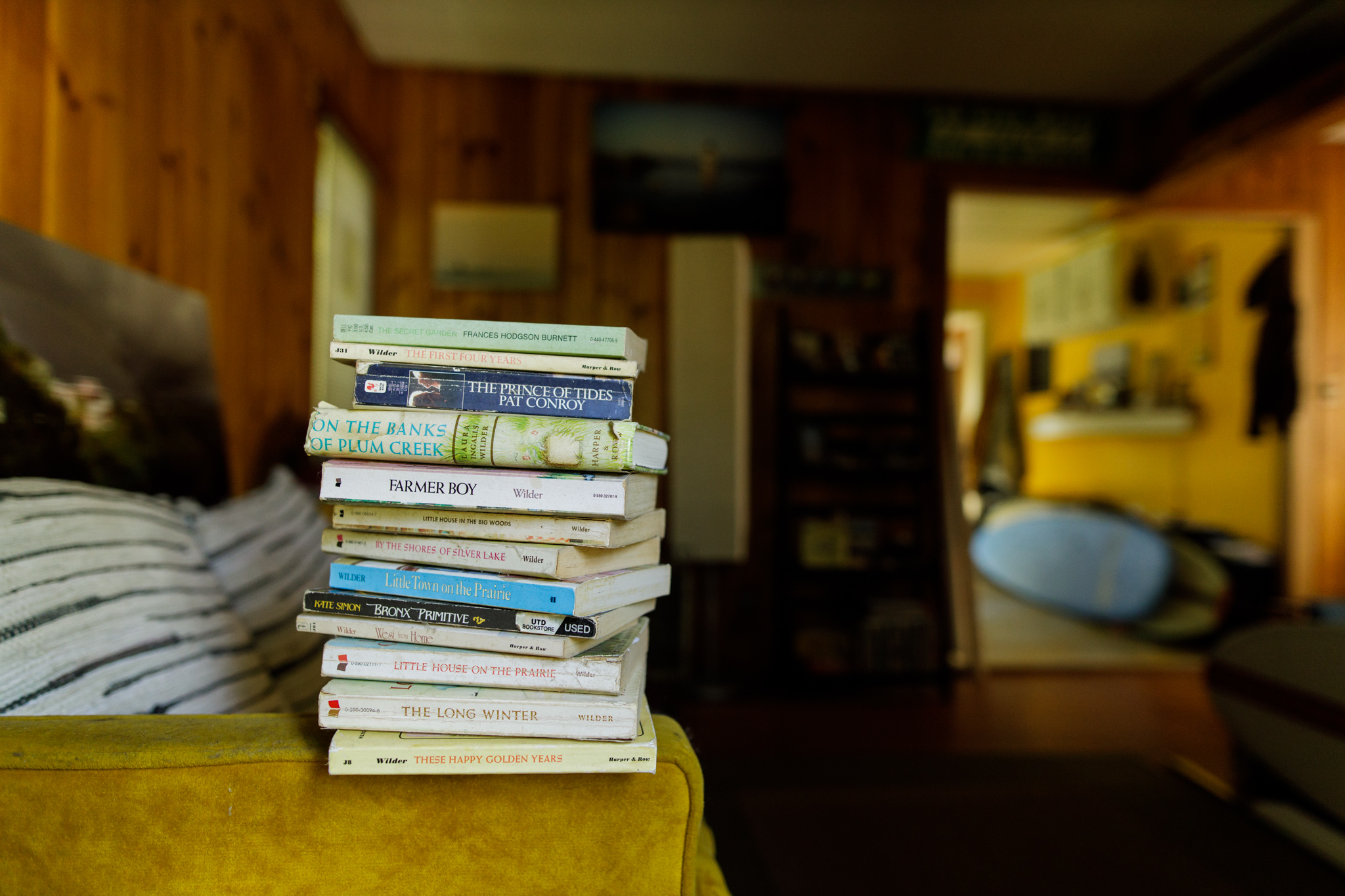 books on the arm of a couch