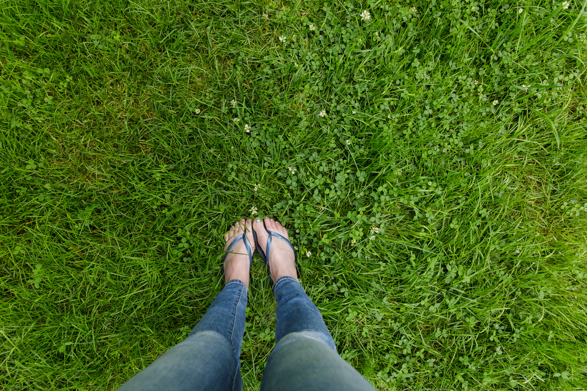 image of feet in grass taken from above
