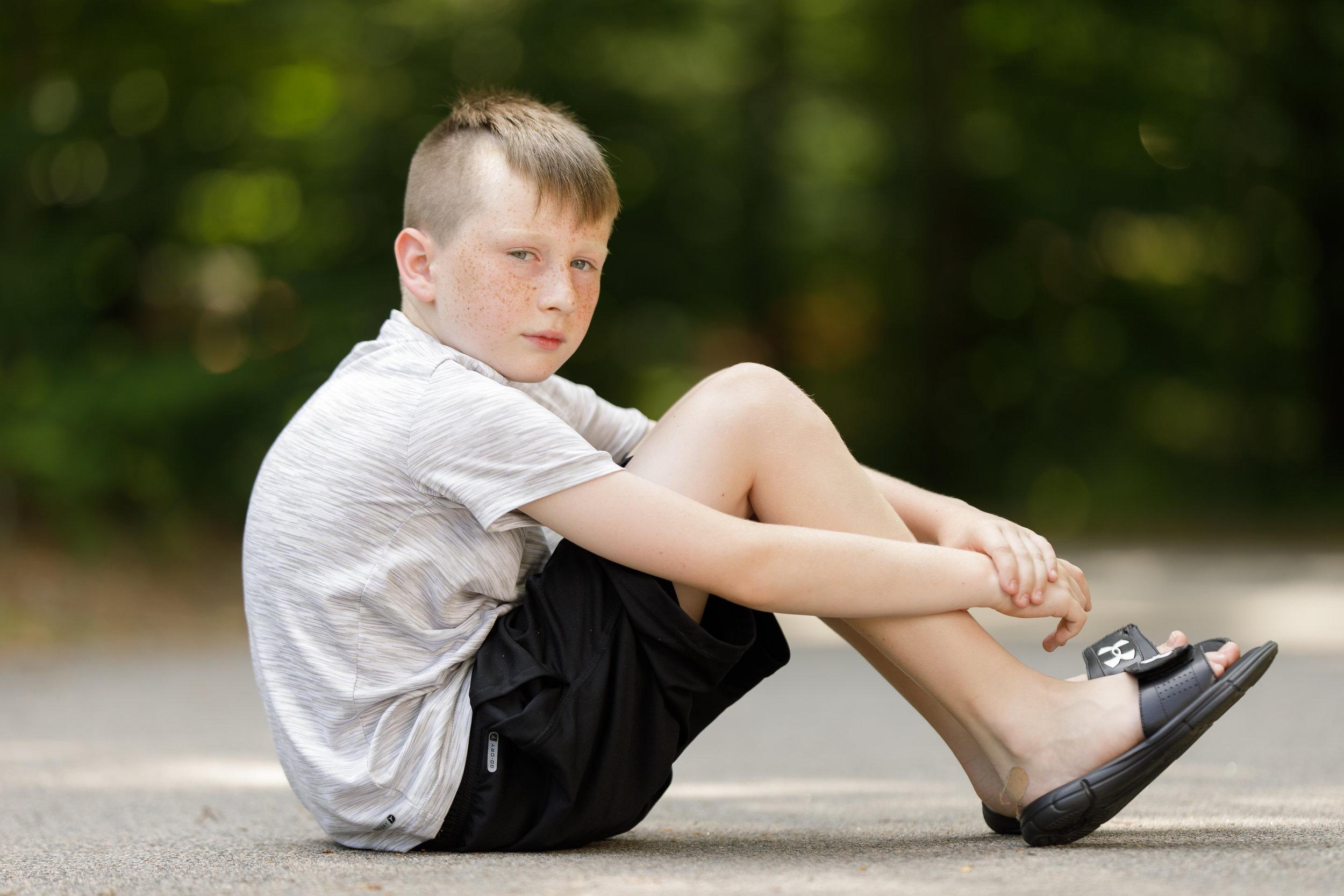 portrait of a boy in a wooded location in Richmond, RI