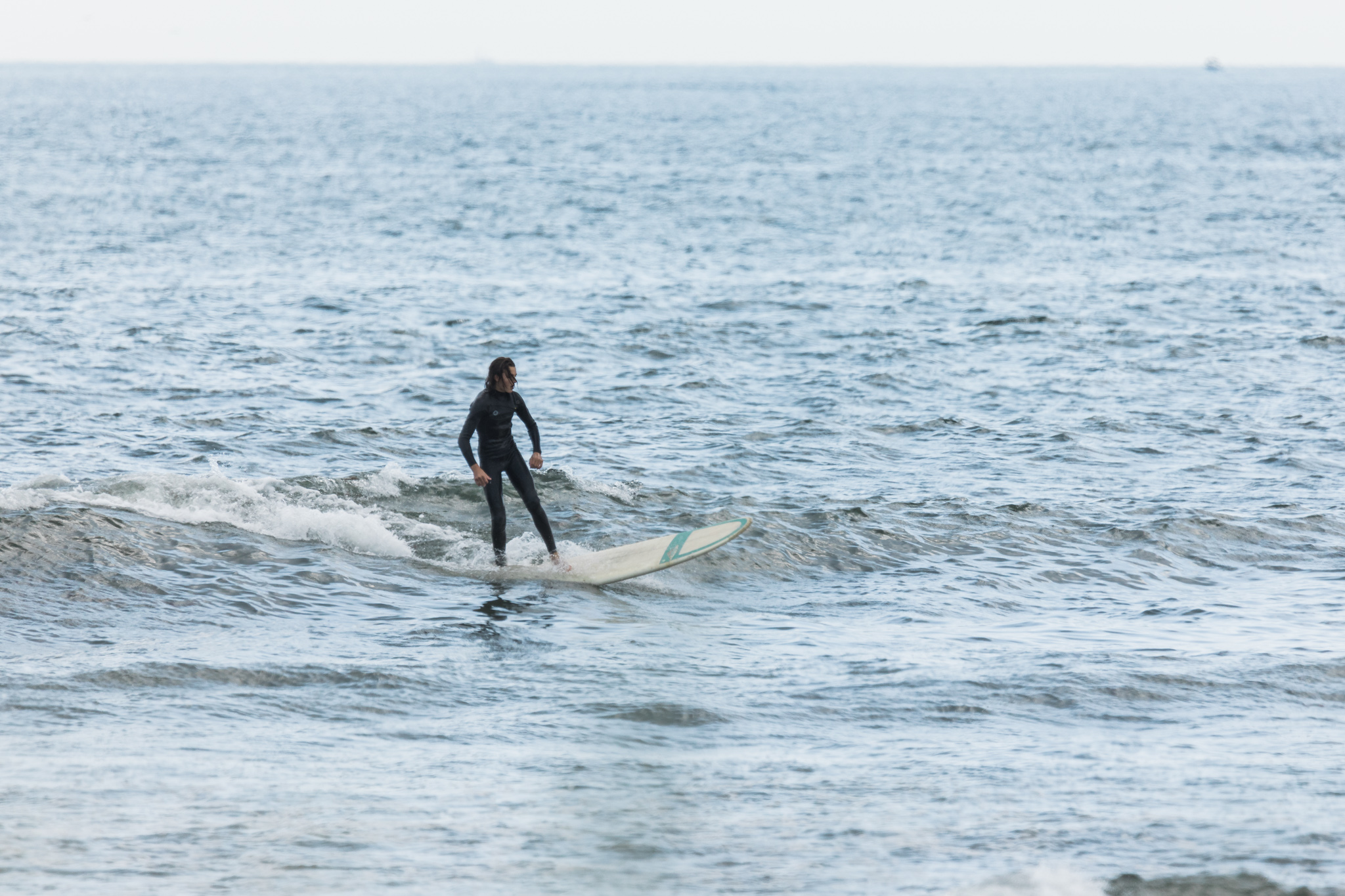 surfer at deep hole in Matunuck, RI