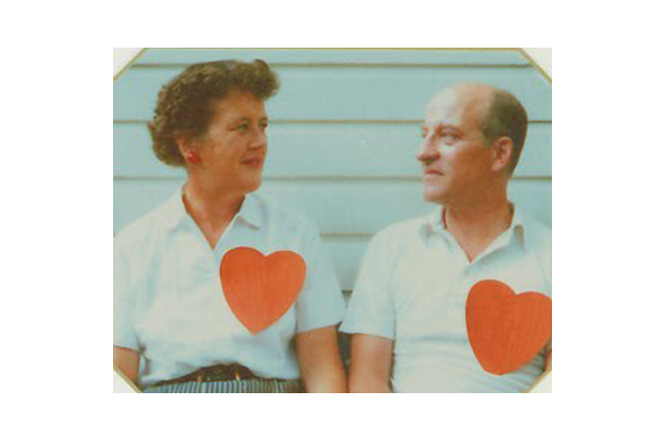 Julia and Paul with their big red hearts.