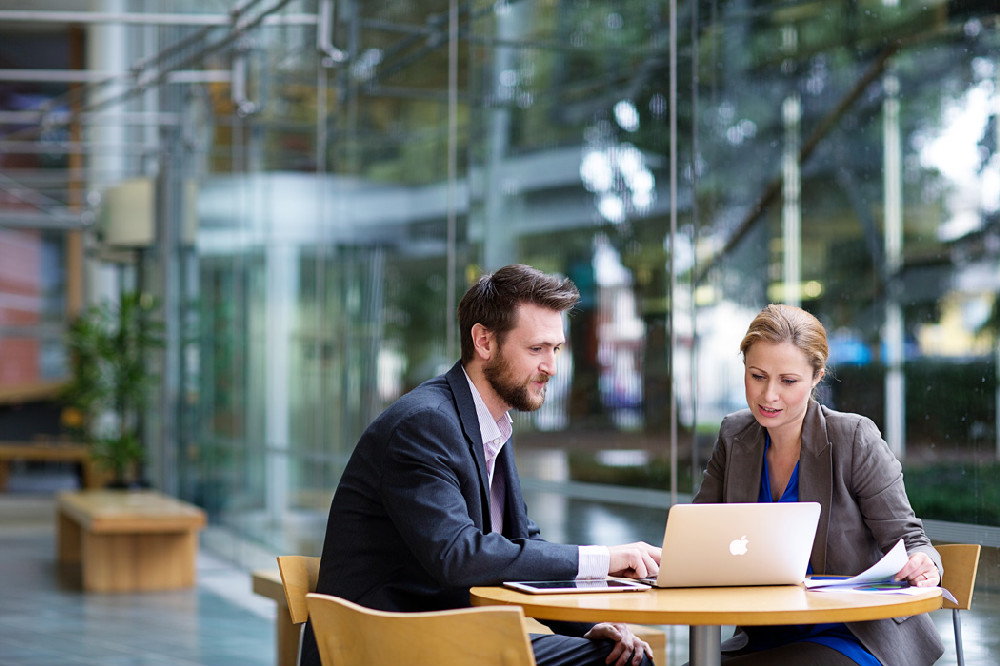 Businesspeople_Tablet - put with mentoring page.jpg