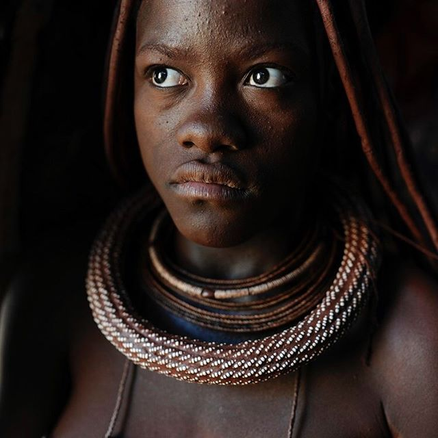Wow! The Himba.  In two weeks I will be in #Namibia again. And this year I'm not just going to drive around with guests; I will be spending quite some time on my own in the #bush. This week I decided that I will use at least part of that to visit and #photograph the Himba.  I've been so many times in Namibia now and every now and then I realise how the beauty of the country can kind of fade away in my mind. I guess it's a kind of inflation of the senses or something; I notice it more often. Maybe it is very normal if you travel as much as I do.  I took these #photographs in 2015 and today I discovered that I didn't even edit them afterwards; they were just there on my hard drive…never looked at them again. But now I do and I feel: WOW!  The #beauty of these people, the way in which they live their lives almost exactly the same as they did a hundred years ago.  The way they welcome me. We can hardly understand each other, but there is always contact and warmth. And humor. It often seems to me that these people are not bothered by all those things that make our lives so complicated, such as haste, greed and all sorts of nonsensical worries. Perhaps just in one word: fear.  I also reread this fascinating BBC article online, about how the Himba have a completely different perception of the world around us. They literally SEE differently and don't recognise the colours that we see.  Anyway, enough reasons to really pay attention to this and that is exactly what I'm planning to do.  There's another good reason for that as well. There are a few major threats lurking for #Kaokoland - the area where the Himba live. There are serious plans for a huge dam in the #Kunene River and a sea port on the #Skeleton #Coast, with a rail connection right through the heart of Kaokoland.  It is possible that all this beauty will have disappeared in 10 years time.