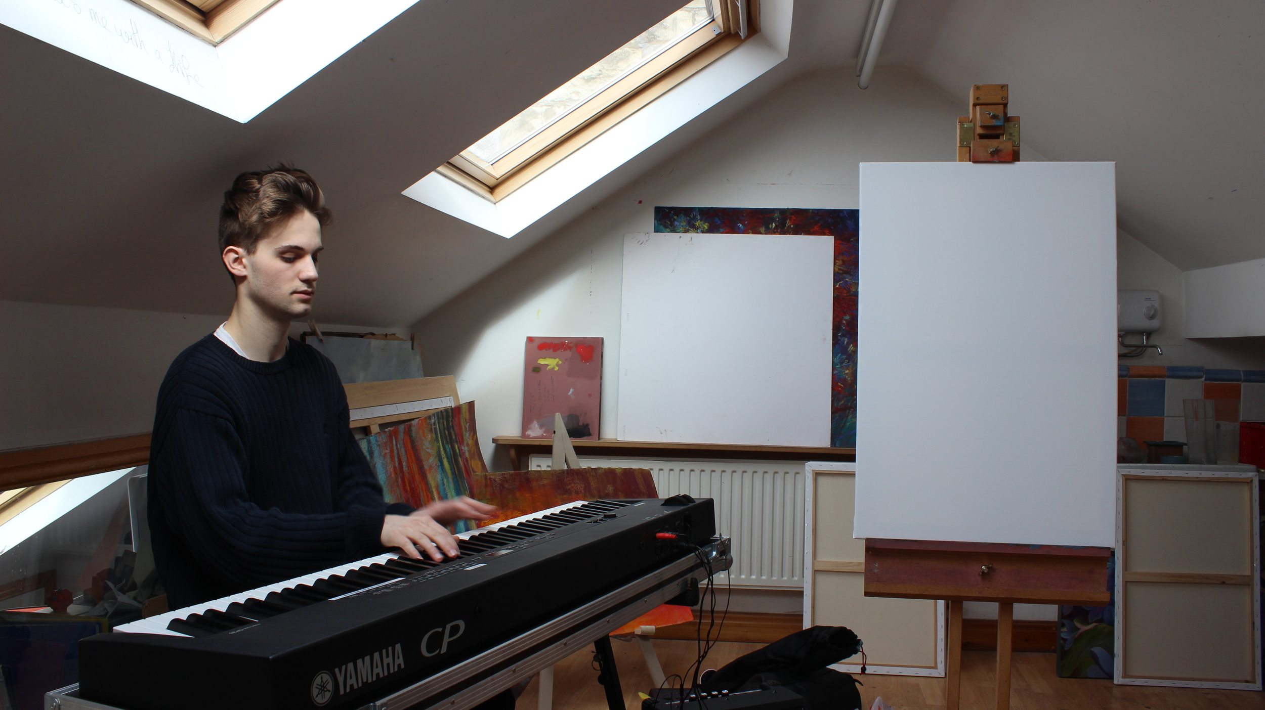 Arthur plays Debussy during a painting and music session with Steve at Nel Whatmore's home studio
