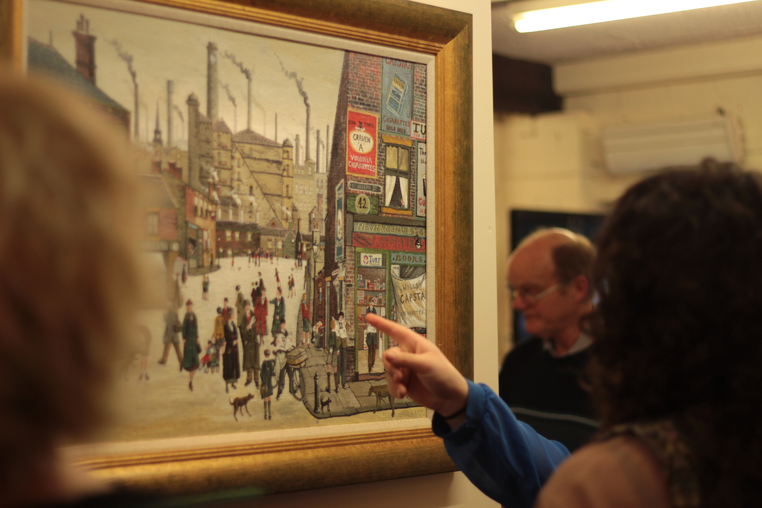 Guests examine Allen Tortice's largest work yet and perhaps his masterpiece -  Our Town .