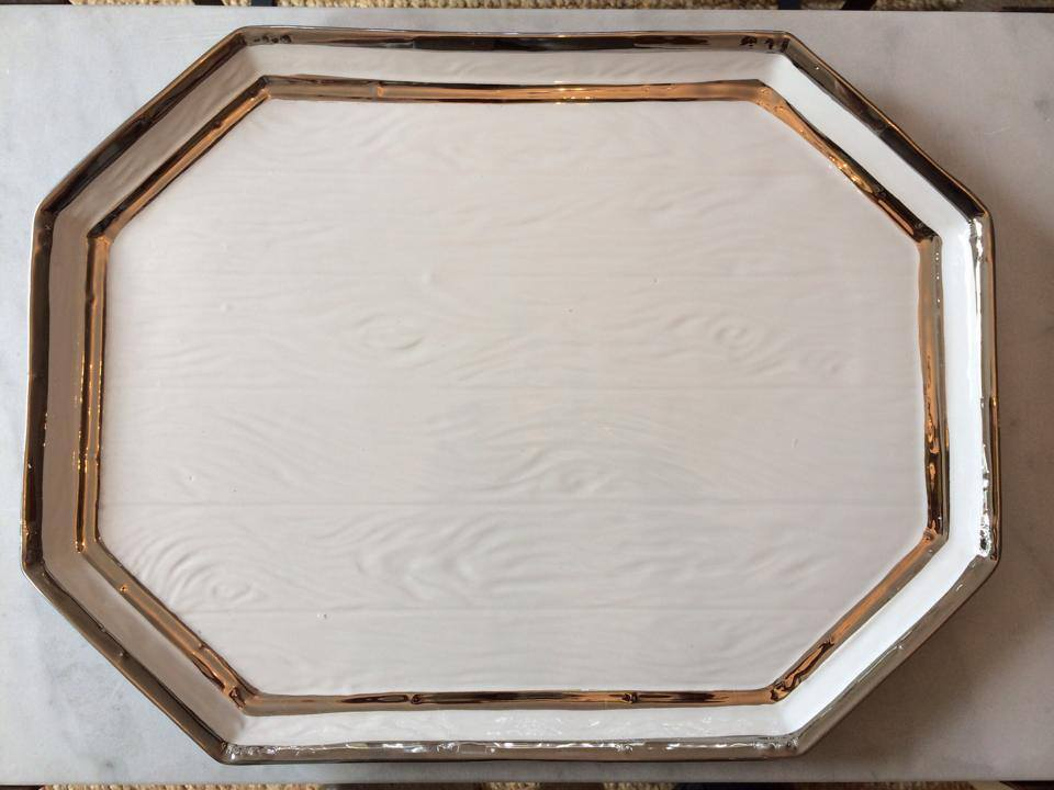 we've got lots of lovely trays at home with heart, and our current favorite is this porcelain faux bois stunner, prettily silvered on the edges.  we especially love trays because they're so cleverly multi-use; they look gorgeous, and also corral stuff -- the sort and define effect, you could say, all while looking chic and glam and all of that.  take a look below as we put this pretty tray through its paces ....