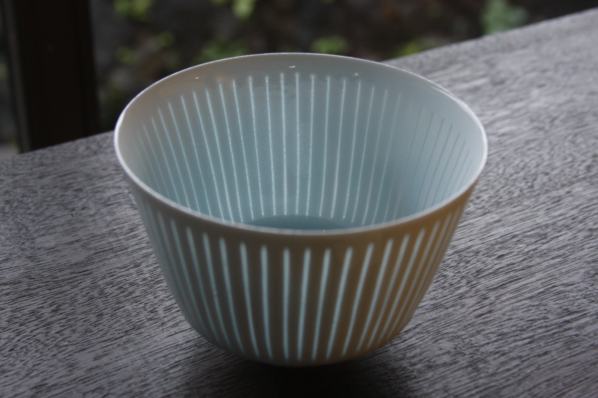 A cup with Ikura's signature style translucent stripes