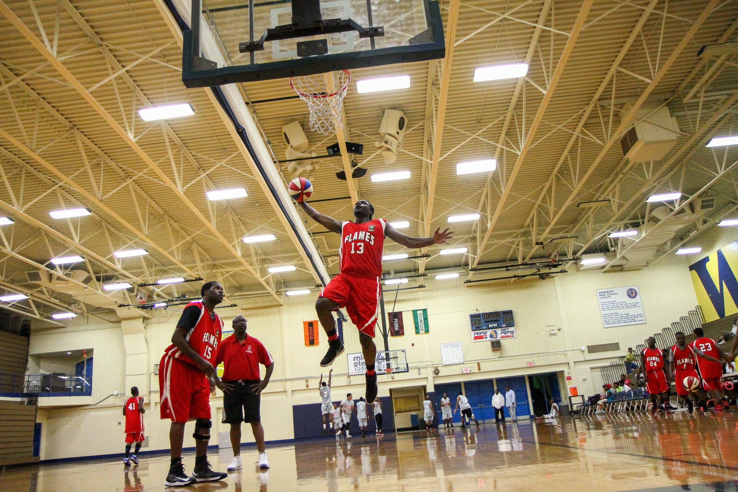 Midwest Flames player number 13 attempts a dunk during warm ups.