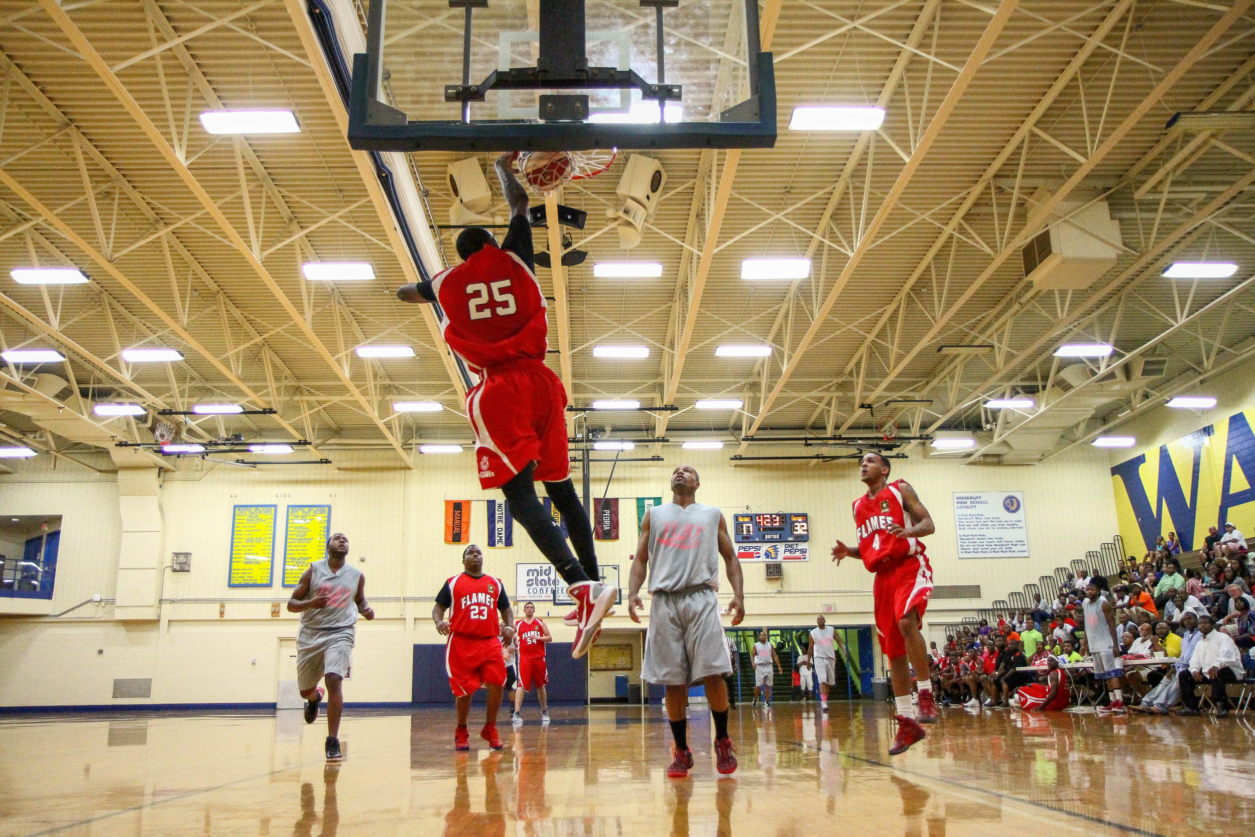 Midwest Flames player number 25 dunks during an exhibition game between the Midwest Flames vs Chicago Fury