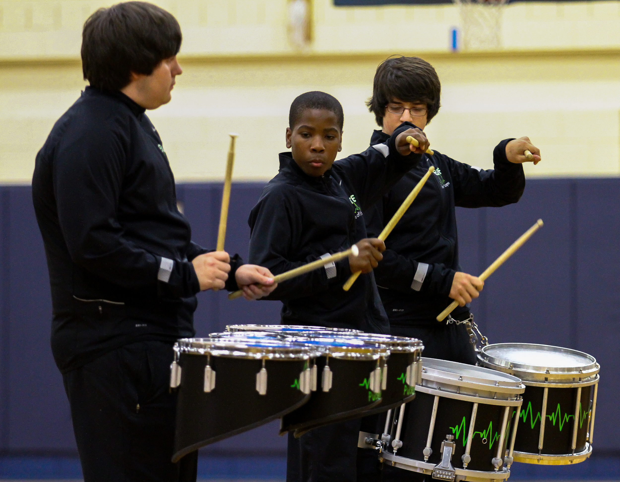 Peoria E.L.I.T.E. Pulses of Hope drummers performs before the start of the Kansas City Monarch vs Midwest Flames game at Woodruff High School in Peoria, IL
