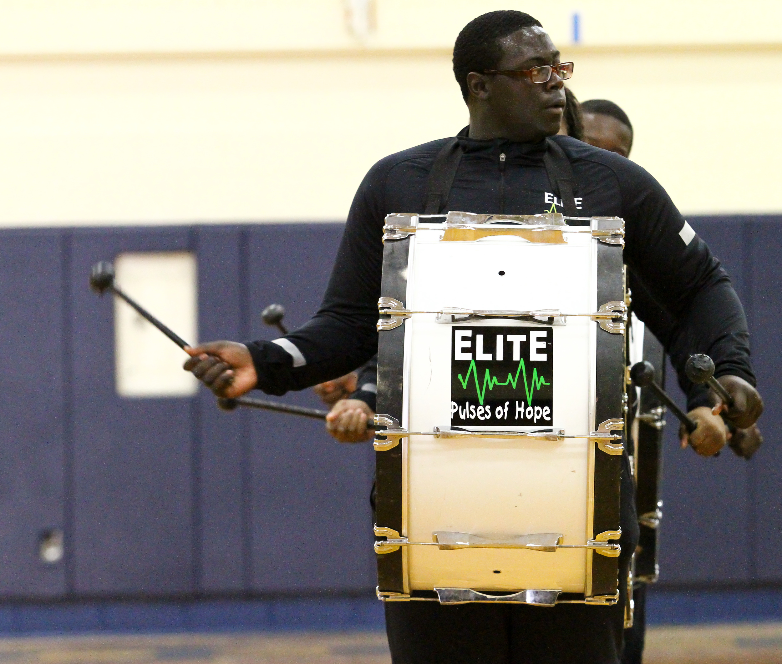 One of the three Pulses of Hope Base drummer performs before the start of the King City Monarchs vs Midwest Flames game at Woodruff High school in Peoria, IL.