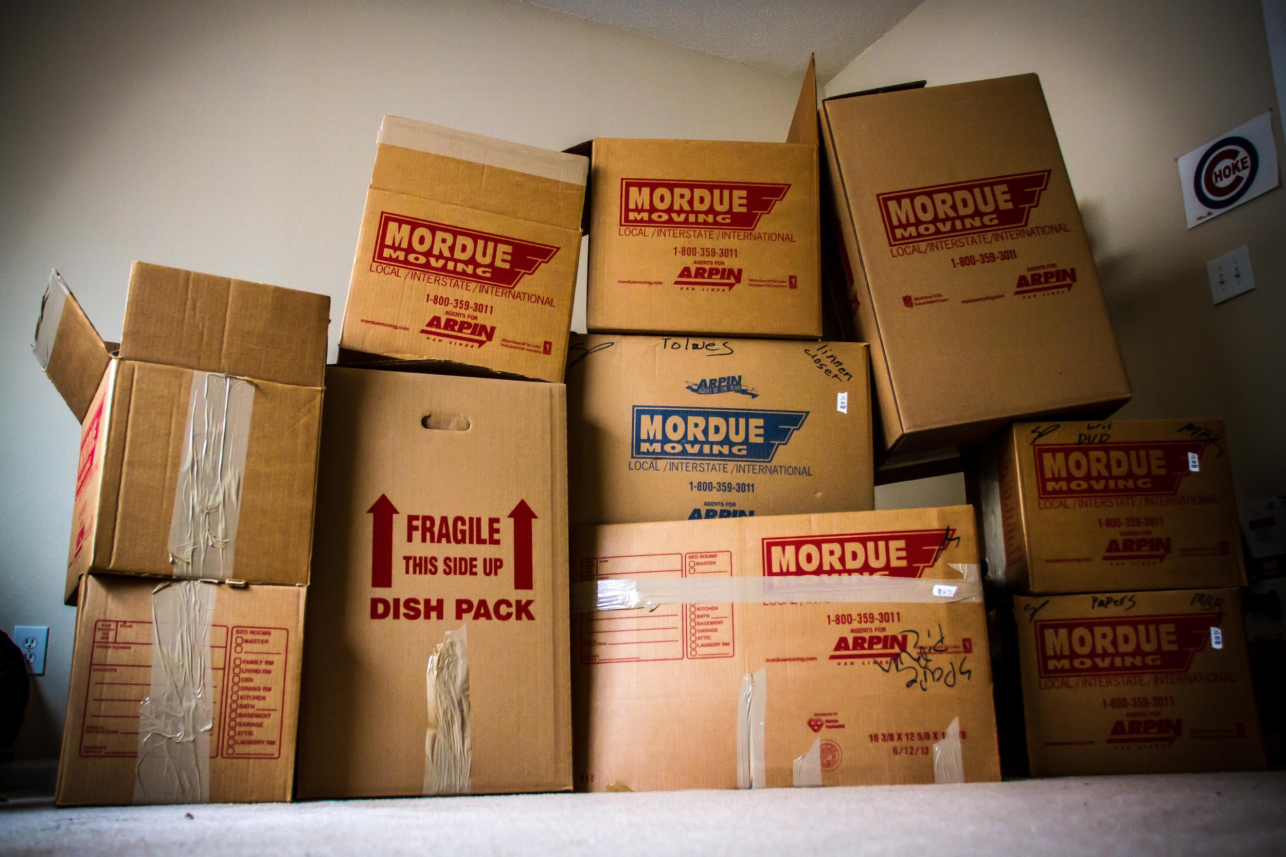 Here is a shot of some of the boxes I have left from my move. Mordue was the company that moved my stuff. I played around with a few arrangements and like this shot the most. This was a basic shot with my Canon 7D with a Sigma 18-200mm at F4.0, 1/60 sec, 1000 ISO using available light coming from the window. Also with a little post processing with Adobe Lightroom