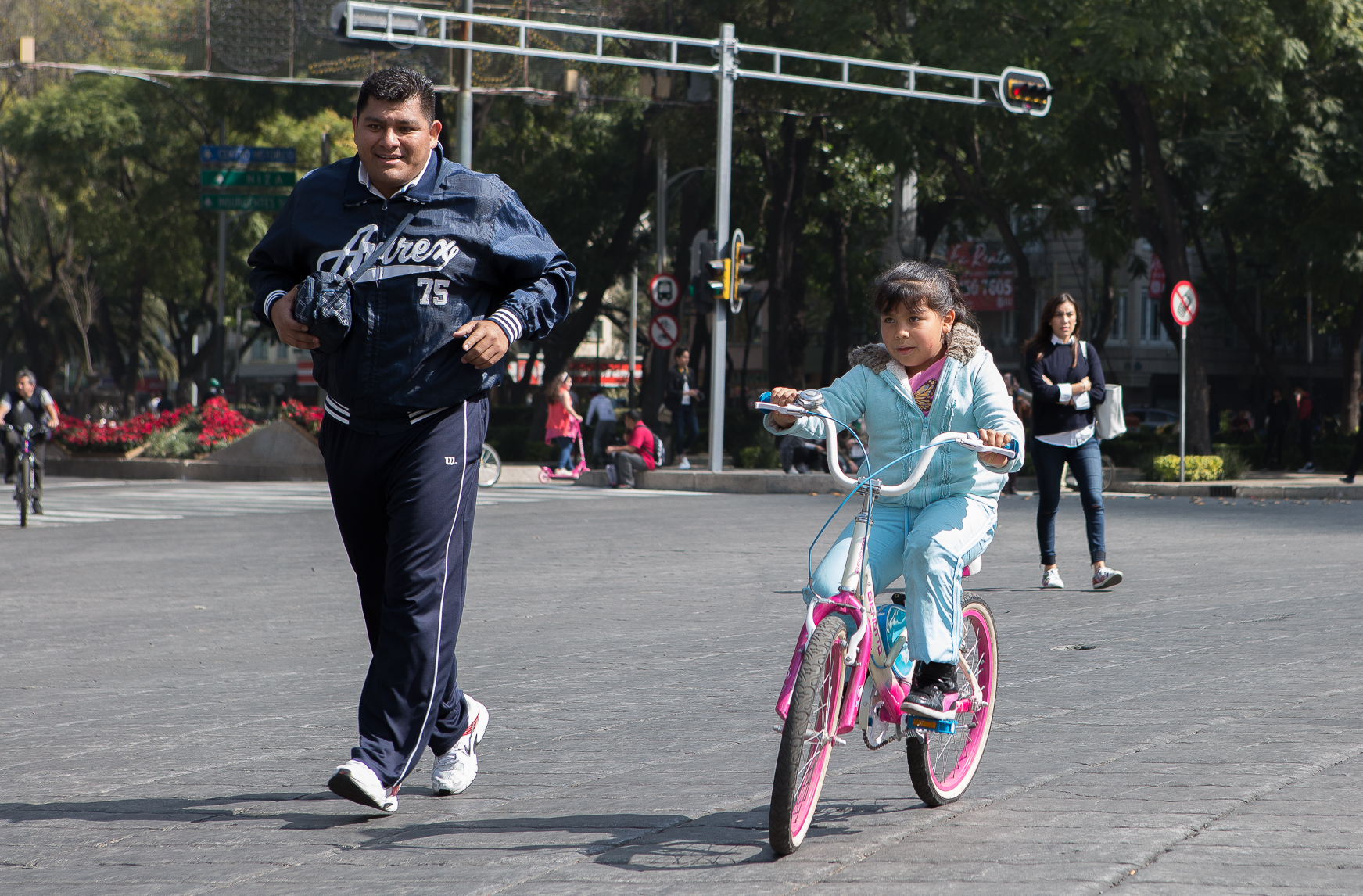 Captured this cute moment of a father running with his daughter as she biked around Angel de la Independecia (Angel of Independence) in Mexico City, Mexico.