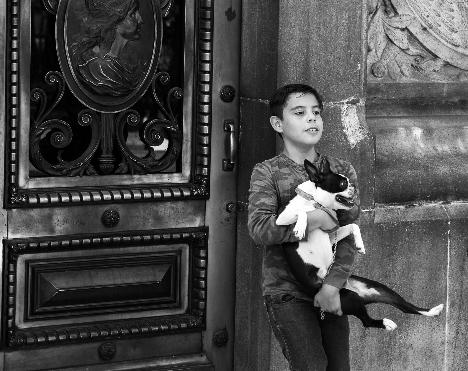 Just a boy and his dog posing for pictures in front of a door by the Angel de la Independecia (Angel of Independence) in Mexico City, Mexico