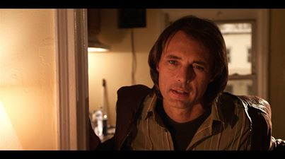 Bobby Blue Day (James Wilder) at Jack's apartment. Still from the film.