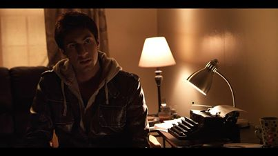 Jack (Zuher Khan) at his typewriter. Still from the film.