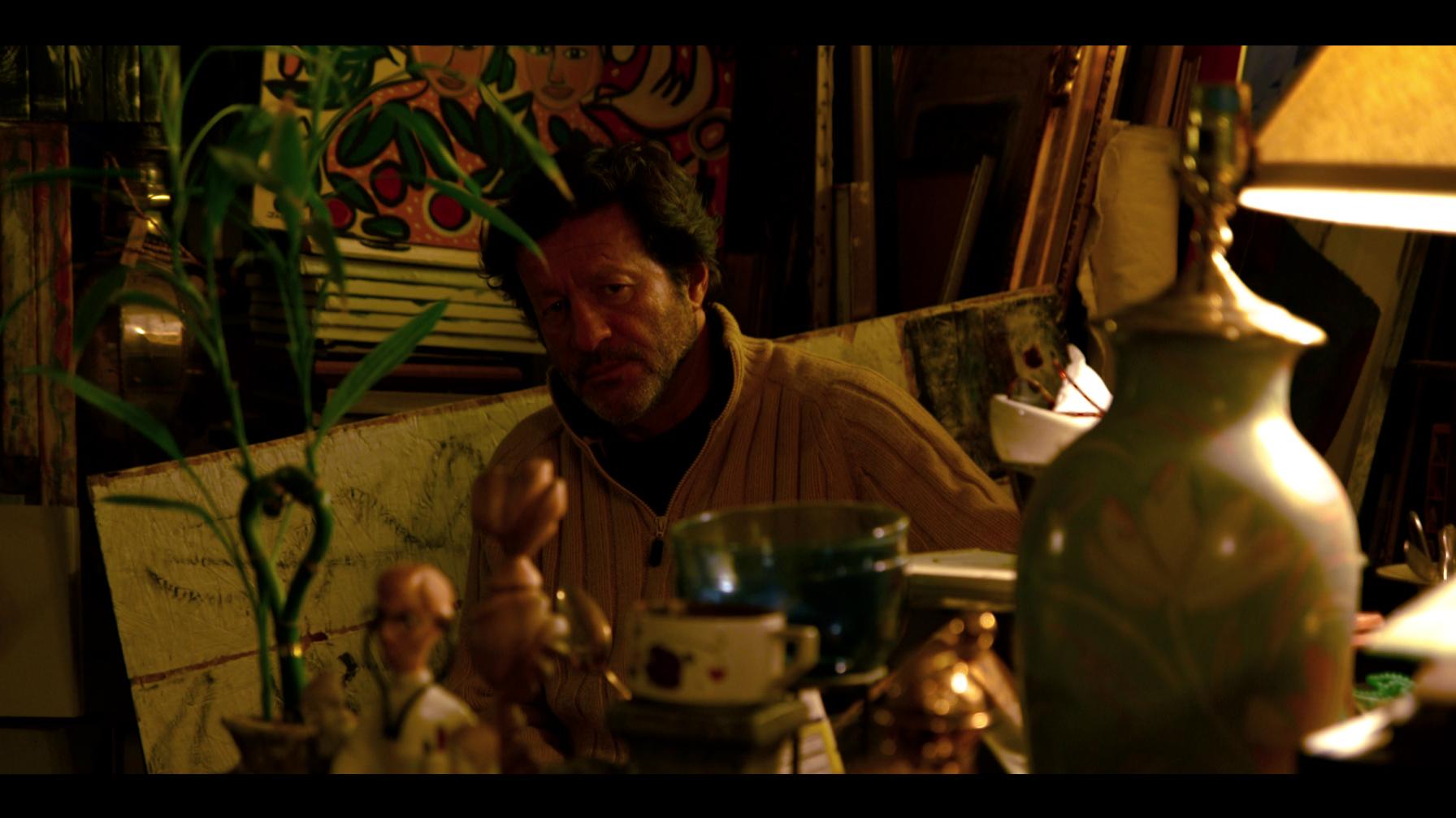 Joey the Junkman (Joaquim de Almeida) in his junk store. Still from the film.